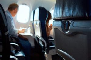 passanger in aircraft cabin. Interior passenger airliner cabin.